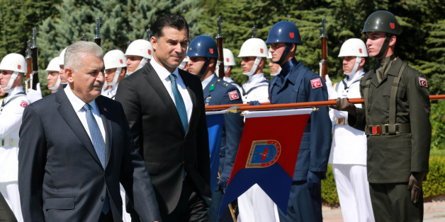 Turkey's Prime Minister Binali Yildirim (L) and Turkish Republic of Northern Cyprus (TRNC) Prime Minister Huseyin Ozgurgun inspect an honor guard during an official welcoming ceremony at the Cankaya Palace in Ankara on July 26, 2016. The UN said on July 21 it was concerned that the failed coup attempt in Turkey could dampen prospects for Cyprus' peace process aimed at reunifying the divided Mediterranean island. / AFP / ADEM ALTAN        (Photo credit should read ADEM ALTAN/AFP/Getty Images)
