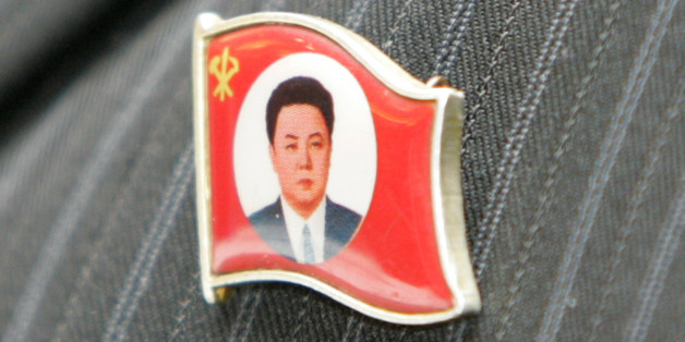 A North Korean labour union leader wears an insignia representing North Korean leader Kim Jong-il during an inter-Korean Labour Day celebration in Changwon, about 400 km (249 miles) southeast of Seoul, April 30, 2007. Sixty labourers and officials from the North arrived in the South on Sunday to participate in a joint Labour Day celebration with South Korea's Korean Confederation of Trade Unions and the Federation of Korean Trade Unions. The celebration, which is the first of such inter-Korean L