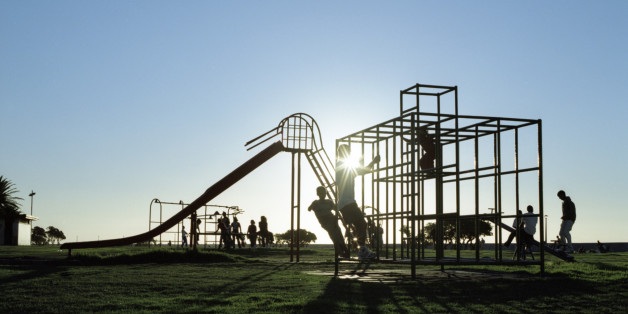 Silhouettes of children in playground