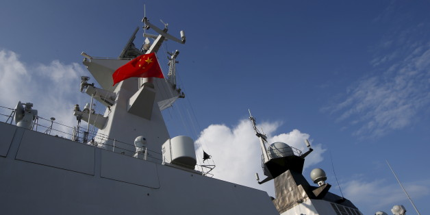 A Chinese People's Liberation Army (PLA) navy personnel looks out of their Jiangkai II class vessel, CNS Yulin,  during a display of warships ahead of the IMDEX Asia maritime defence exhibition at Changi Naval Base in Singapore May 18, 2015. The 10th international maritime defence show which sees participation from 180 exhibitors and delegations from over 40 countries takes place from May 19 to 21. REUTERS/Edgar Su
