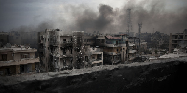 FILE - In this Tuesday, Oct. 2, 2012 file photo, smoke rises over Saif Al Dawla district, in Aleppo, Syria. Russia and the Syrian government will open humanitarian corridors in Syria's embattled city of Aleppo and offer a way out for opposition fighters wanting to lay down their arms, Russia's defense minister Sergei Shoigu announced on Thursday, July 28, 2016. (AP Photo/ Manu Brabo, File)