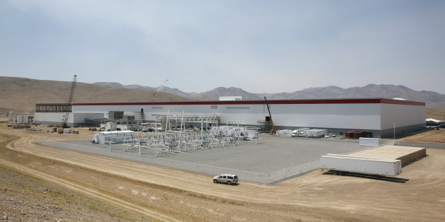 An overall view of the new Tesla Gigafactory is seen during a media tour Tuesday, July 26, 2016, in Sparks, Nev. It's Tesla Motors' biggest bet yet: A massive, $5 billion factory in the Nevada desert that could almost double the world's production of lithium-ion batteries by 2018. (AP Photo/Rich Pedroncelli)