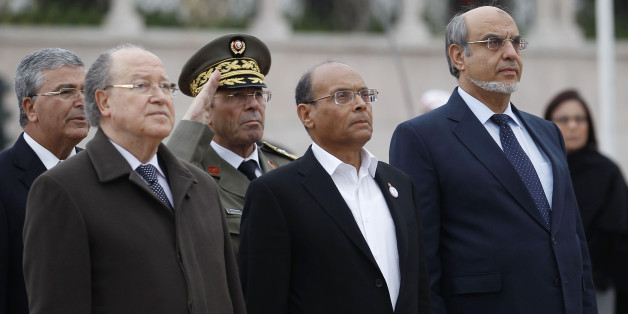 Tunisian Prime Minister Hamadi Jebali (R), President Moncef Marzouki (front C) and President of the Constituent Assembly Mustapha Ben Jaafar (front L) listen to playing of the national anthem during a ceremony marking the second year anniversary of the revolution in Tunis January 14, 2013. REUTERS/Zoubeir Souissi (TUNISIA - Tags: POLITICS ANNIVERSARY)
