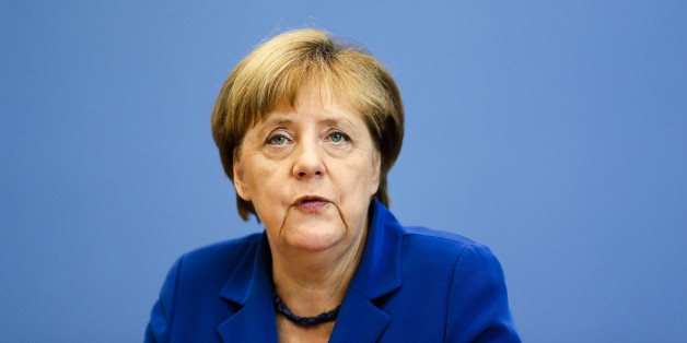 "German Chancellor Angela Merkel attends a news conference in Berlin Thursday, July 28, 2016. Chancellor Angela Merkel says the fact that two men who came to Germany as refugees carried out attacks claimed by the Islamic State group ""mocks the country that took them in."" Merkel pledged to do everything to clear up the ""barbaric acts,"" find out who was behind them and bring them to justice. (AP Photo/Markus Schreiber)"