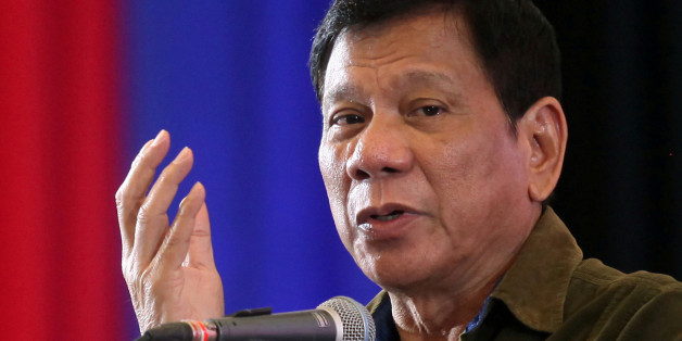 "Philippine President-elect Rodrigo Duterte speaks during a conference with businessmen in Davao city, southern Philippines June 21, 2016. REUTERS/Lean Daval Jr/File Photo  FROM THE FILES PACKAGE - SEARCH ""SOUTH CHINA SEA FILES"" FOR ALL IMAGES"