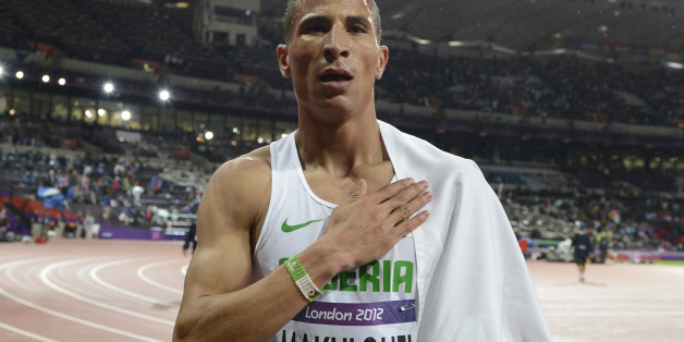 Algeria's Taoufik Makhloufi celebrates after winning the men's 1500m final at the athletics event during the London 2012 Olympic Games on August 7, 2012 in London. AFP PHOTO / ADRIAN DENNIS        (Photo credit should read ADRIAN DENNIS/AFP/GettyImages)