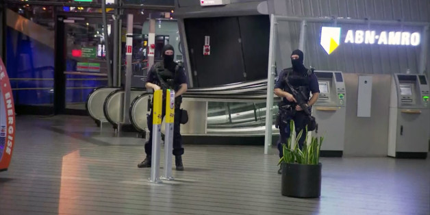 """This image made from a video from RTL shows police at Schiphol Airport in Amsterdam, Tuesday, April 12, 2016. Military police have arrested a man and are conducting an investigation at the airport after a report of a """"suspicious situation."""" (RTL via AP) NETHERLANDS OUT; LUXEMBOURG OUT"""