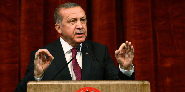 Turkey President Recep Tayyip Erdogan gives a speech commemorating those killed and wounded during a failed July 15 military coup, in Ankara, Turkey, late Friday, July 29, 2016. The government crackdown in the coup's aftermath has strained Turkey's ties with key allies including the United States. (AP Photo/Kayhan Ozer Presidential Press Service, via AP Pool)