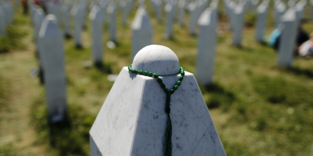 A rosary is placed on a tombstone at the Memorial Center Potocari, near Srebrenica, Bosnia and Herzegovina July 11, 2015. The bodies of the 136 recently identified victims of Srebrenica massacre are buried in Potocari during ceremonies to mark the 20th anniversary of the massacre. Abandoned by their U.N. protectors toward the end of a 1992-95 war, 8,000 Muslim men and boys were executed by Bosnian Serb forces over five July days, their bodies dumped in pits then dug up months later and scattered in smaller graves in a systematic effort to conceal the crime.     REUTERS/Antonio Bronic