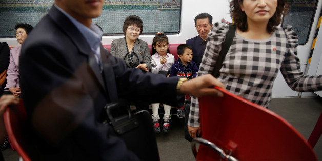 Passengers travel on a recently introduced new train during a government organised visit to the subway for foreign reporters in central Pyongyang, North Korea May 7, 2016.  REUTERS/Damir Sagolj