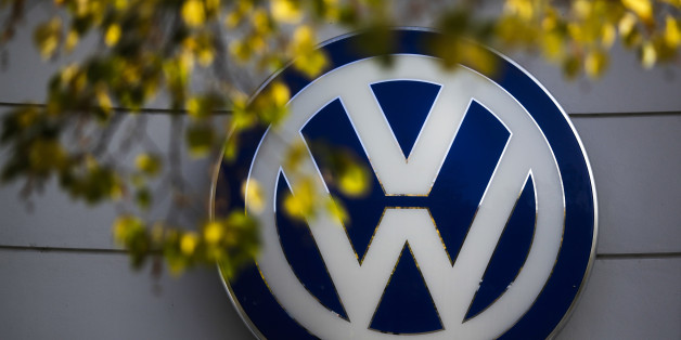 FILE - In this Oct. 5, 2015, file photo, the VW sign of Germany's Volkswagen car company is displayed at the building of a company's retailer in Berlin. Volkswagen diesel owners can choose to either sell their car back to the company or get a repair that could diminish the vehicle's performance under a settlement of claims tied to the German automaker's emissions-cheating scandal. (AP Photo/Markus Schreiber, File)