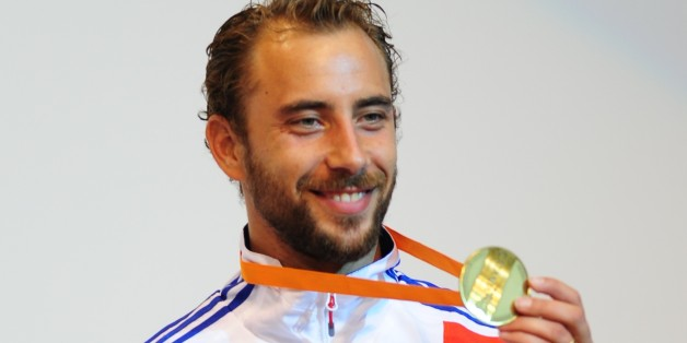 Silver medalist France's Victor Sintes poses on the podium of the Men's Foil competition at the 2011 World Fencing Championships in Catania on October 13, 2011.  Italy's Valerio Aspromonte took silver and Italy's Giorgio Avola and French Victor Sintes got bronze.   AFP PHOTO / GIUSEPPE CACACE (Photo credit should read GIUSEPPE CACACE/AFP/Getty Images)