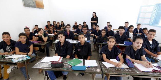 "Teacher Manel el Ayachi poses for a picture on the first day of a new school year at Linine Street  Preparatory School in Tunis, Tunisia, September 16, 2015. Schools have reopened, with around 2 million pupils heading back to classrooms after a three-month summer break. Nearly three years after Taliban gunmen shot Pakistani schoolgirl Malala Yousafzai, the teenage activist last week urged world leaders gathered in New York to help millions more children go to school. World Teachers' Day falls on 5 October, a Unesco initiative highlighting the work of educators struggling to teach children amid intimidation in Pakistan, conflict in Syria or poverty in Vietnam. Even so, there have been some improvements: the number of children not attending primary school has plummeted to an estimated 57 million worldwide in 2015, the U.N. says, down from 100 million 15 years ago. Reuters photographers have documented learning around the world, from well-resourced schools to pupils crammed into corridors in the Philippines, on boats in Brazil or in crowded classrooms in Burundi.  REUTERS/Anis MiliPICTURE 28 OF 47 FOR WIDER IMAGE STORY ""SCHOOLS AROUND THE WORLD""SEARCH ""EDUCATORS SCHOOLS"" FOR ALL IMAGES"