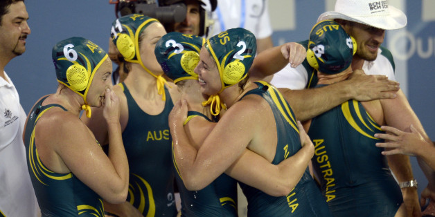 Australian players celebrate after their victory over Russia in a women's water polo semifinal at the FINA Swimming World Championships in Barcelona, Spain, Wednesday, July 31, 2013 .(AP Photo/Manu Fernandez)