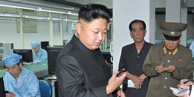 North Korean leader Kim Jong-Un visits the May 11 Factory in this undated photo released by North Korea's Korean Central News Agency (KCNA) in Pyongyang August 11, 2013. REUTERS/KCNA (NORTH KOREA - Tags: POLITICS BUSINESS TELECOMS) ATTENTION EDITORS - THIS PICTURE WAS PROVIDED BY A THIRD PARTY. REUTERS IS UNABLE TO INDEPENDENTLY VERIFY THE AUTHENTICITY, CONTENT, LOCATION OR DATE OF THIS IMAGE. FOR EDITORIAL USE ONLY. NOT FOR SALE FOR MARKETING OR ADVERTISING CAMPAIGNS. NO THIRD PARTY SALES. NOT