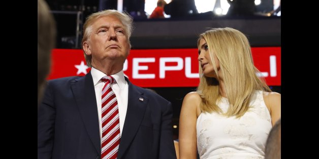 Republican U.S. presidential nominee Donald Trump stands in the Trump family box with his daughter Ivanka (R), awaiting the arrival onstage of his son Eric at the conclusion of former rival candidate Senator Ted Cruz's address, during the third night at the Republican National Convention in Cleveland, Ohio, U.S. July 20, 2016. REUTERS/Aaron P. Bernstein