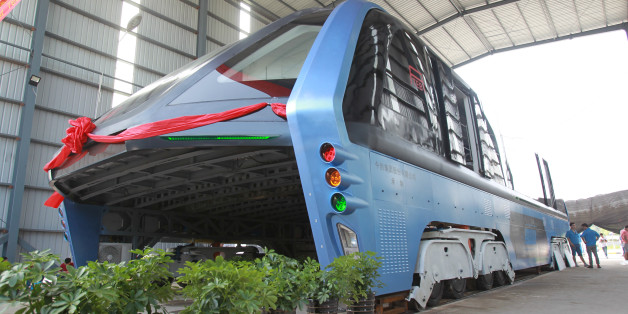 A model of an innovative street-straddling bus called Transit Elevated Bus is seen after a test run in Qinhuangdao, Hebei Province, China, August 3, 2016. The test bus currently consists of one segment, and is capable of carrying 300 people, according to local media. REUTERS/Stringer ATTENTION EDITORS - THIS IMAGE WAS PROVIDED BY A THIRD PARTY. EDITORIAL USE ONLY. CHINA OUT. NO COMMERCIAL OR EDITORIAL SALES IN CHINA.
