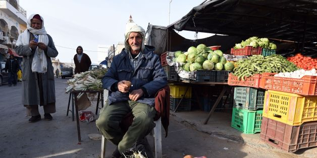Tunisian vendor Chahbani Larayadh, 80, sells white truffles at a market on February 6, 2016 in the town of Ben Guerdane, some 40 kilometres west of the Libyan border.