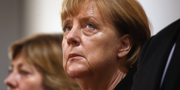 MUNICH, GERMANY - JULY 31:  German chancellor Angela Merkel attends a memorial service for the victims of last week's shooting spree that left nine victims dead on July 31, 2016 in Munich, Germany. David Ali Sonboly, an 18-year-old German of Iranian descent, killed nine people in a shooting spree near and in a shopping center before killing himself in a park. Investigators have found evidence Sonboly found inspiration in the 2011 mass shooting in Norway by Anders Breivik.  (Photo by Johannes Sim