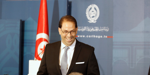 Tunisia's Prime Minister-designate Youssef Chahed smiles during a news conference after his meeting with Tunisia's President Beji Caid Essebsi (not pictured) in Tunisia, Tunis August 3, 2016. REUTERS/Zoubeir Souissi