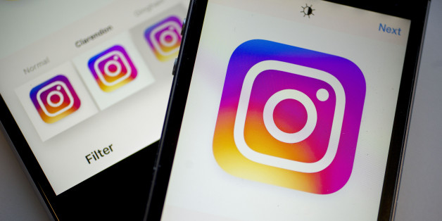Facebook Inc.'s Instagram logo is displayed on the Instagram application on an Apple Inc. iPhone in this arranged photograph taken in Washington, D.C., U.S., on Friday, June 17, 2016. In a bid to give its users an incentive to create more content for the photo and video-sharing site, Facebook's Instagram is considering sharing revenue generated from news, sports, celebrities and other content said Carolyn Everson, vice president for global marketing solutions at Facebook. Photographer: Andrew Ha