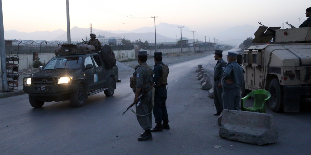 Afghan police guard on a road leading to the site of an explosion, in Kabul, Afghanistan, Monday, Aug. 1, 2016. A strong explosion took place early Monday near a guesthouse for foreigners in Kabul, an Afghan police official said. (AP Photos/Massoud Hossaini)