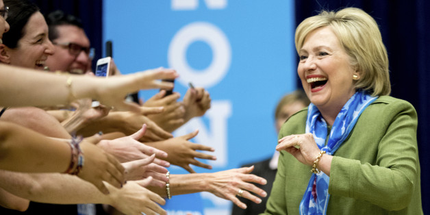 Democratic presidential candidate Hillary Clinton arrives at a rally at Adams City High School in Commerce City, Colo., Wednesday, Aug. 3, 2016. (AP Photo/Andrew Harnik)