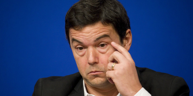 "French economist and academic Thomas Piketty attends a symposium ""Les Entretiens du Tresor"" at the Bercy Finance Ministry in Paris January 23, 2015. Piketty's book ""Capital in the Twenty-First Century"" has attracted praise and invective alike on its way to the top of the  best-seller list.   REUTERS/Charles Platiau (FRANCE - Tags: BUSINESS POLITICS HEADSHOT)"