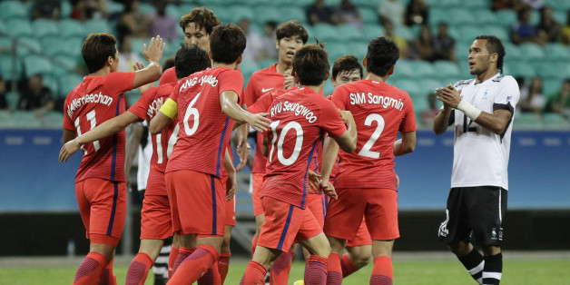 Players of Korea celebrate after scoring during a group C match of the men's Olympic football tournament between Fiji and Korea at the Fonte Nova Arena in Salvador, Brazil, Thursday, Aug. 4, 2016. (AP Photo/Arisson Marinho)