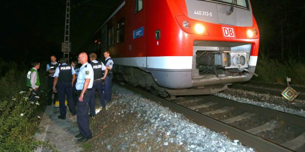 Police officers stand by a regional train in Wuerzburg southern Germany on July 18, 2016 after a man attacked train passengers with an axe. 
