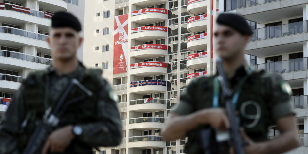Brazilian soldiers patrol outside the Olympic Village ahead of the 2016 Summer Olympics in Rio de Janeiro, Brazil, Thursday, Aug. 4, 2016. (AP Photo/Gregorio Borgia)