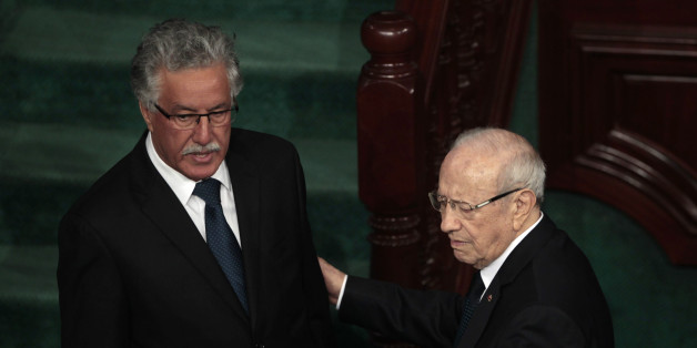 Beji Caid Essebsi (R), leader of Tunisia's secular Nidaa Tounes party and a presidential candidate, speaks with Hamma Hammami , leader of Tunisia's Popular Front Party, in the assembly building in Tunis December 2, 2014. Tunisia's first full elected parliament held its opening session on Tuesday with a challenge to implement the democracy its people sought when they marched in the 2011 revolt against autocrat Zine el-Abidine Ben Ali.REUTERS/Zoubeir Souissi (TUNISIA - Tags: POLITICS ELECTIONS)