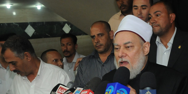 Egyptian Grand Mufti Ali Gomaa holds a press conference in Cairo on April 19, 2012 to clarify the reason behind his latest visit to Jerusalem which caused a stir in his own country, where normalisation of ties with Israel remains a highly sensitive issue. Gomaa, Egypt's highest religious authority, visited the Al-Aqsa mosque compound in Jerusalem on April 18 for the first time, along with Jordan's Prince Ghazi bin Mohammed, King Abdullah II's cousin and adviser on religious affairs.  AFP PHOTO/S
