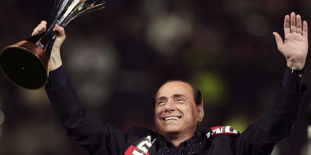 The AC Milan President Silvio Berlusconi lifts the FIFA Club World Cup 2007 trophy before their Italian Serie A match against Napoli at the San Siro Stadium in Milan, January 13, 2008. AC Milan won the title against Argentine club Boca Juniors in Yokohama, south of Tokyo December 16, 2007.   REUTERS/Daniele La Monaca (ITALY)