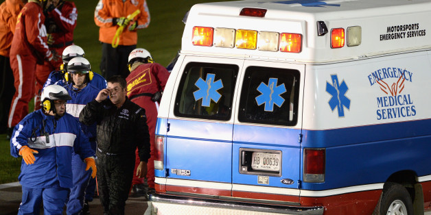 HAMPTON, GA - AUGUST 31:  Jeff Green, driver of the #14 Hefty / Reynolds Toyota, walks to the ambulance after crashing during the NASCAR Nationwide Series Great Clips/Grit Chips 300 at Atlanta Motor Speedway on August 31, 2013 in Hampton, Georgia.  (Photo by Patrick Smith/Getty Images)