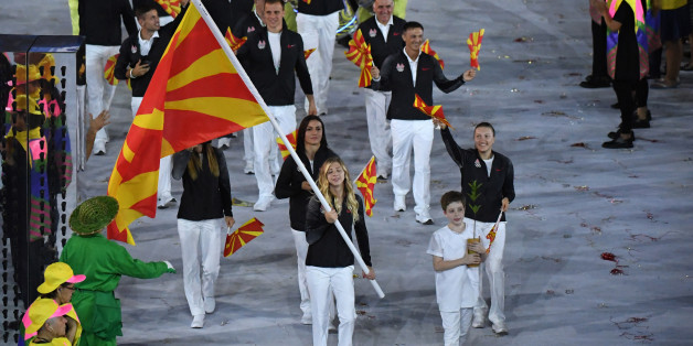 Macedonia's flagbearer Anastasia Bogdanovski leads her delegation during the opening ceremony of the Rio 2016 Olympic Games at the Maracana stadium in Rio de Janeiro on August 5, 2016. / AFP / PEDRO UGARTE        (Photo credit should read PEDRO UGARTE/AFP/Getty Images)