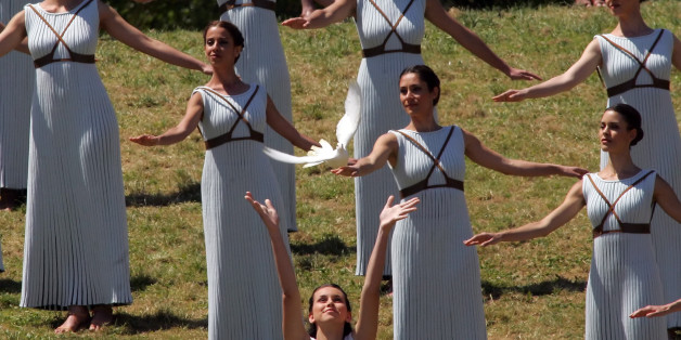 OLYMPIA, GREECE -  21 APRIL:  A priestess releases a white dove during the Lighting Ceremony of the Olympic Flame for the Rio Olympic Games on April 21, 2016 in Olympia, Greece. Torchbearers will carry the Olympic Flame from Ancient Olympia on relay through Greece for eight days before a hand-over ceremony at Panathenian Stadium in Athens.   (Photo by Milos Bicanski/Getty Images)