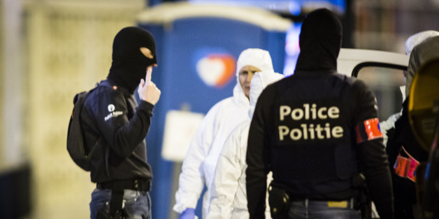 Molenbeek, Brussels, Belgium, 18 March 2016. Forensic researchers in white suits do scientific research at the house where Salam Abdeslam was shot and captured earlier this day. forensic experts talk with police on the scene. A hartshaped logo in the background on a temporary toilet (Photo by Sander de Wilde/Corbis via Getty Images)