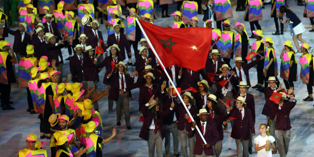 2016 Rio Olympics - Opening ceremony - Maracana - Rio de Janeiro, Brazil - 05/08/2016. Flagbearer Abdelkebir Ouaddar (MAR) of Morocco leads his contingent during the opening ceremony. REUTERS/Ruben Sprich FOR EDITORIAL USE ONLY. NOT FOR SALE FOR MARKETING OR ADVERTISING CAMPAIGNS.