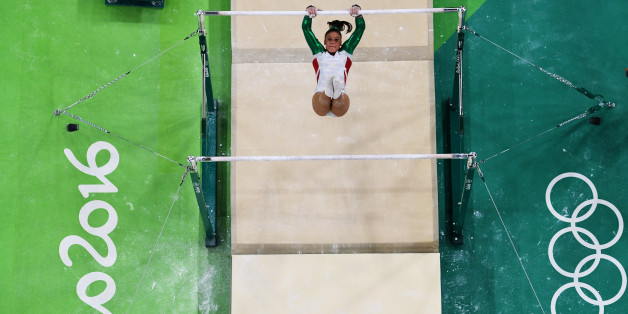 RIO DE JANEIRO, BRAZIL - AUGUST 07:  Farah Boufadene of Algeria competes on the uneven bars during Women's qualification for Artistic Gymnastics on Day 2 of the Rio 2016 Olympic Games at the Rio Olympic Arena on August 7, 2016 in Rio de Janeiro, Brazil.  (Photo by Ian Walton/Getty Images)