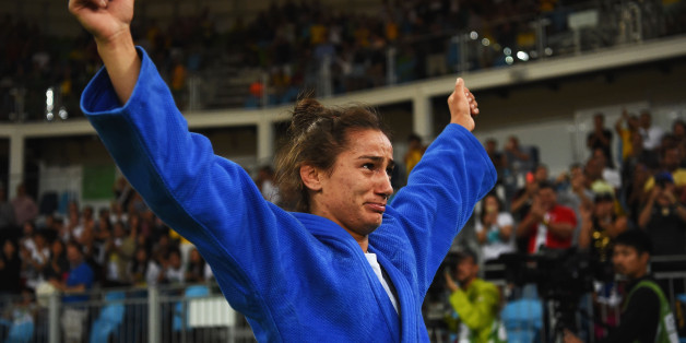 RIO DE JANEIRO, BRAZIL - AUGUST 07:  Majlinda Kelmendi of Kosovo (blue) shows her emotions as she celebrates winning the gold medal against Odette Giuffrida of Italy during the Women's -52kg gold medal final on Day 2 of the Rio 2016 Olympic Games at Carioca Arena 2 on August 7, 2016 in Rio de Janeiro, Brazil.  (Photo by Laurence Griffiths/Getty Images)
