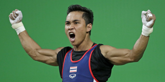 Sinphet Kruaithong, of Thailand, celebrates a successful lift in the men's 56kg weightlifting competition at the 2016 Summer Olympics in Rio de Janeiro, Brazil, Sunday, Aug. 7, 2016. Kruaithong won the bronze medal. (AP Photo/Mike Groll)