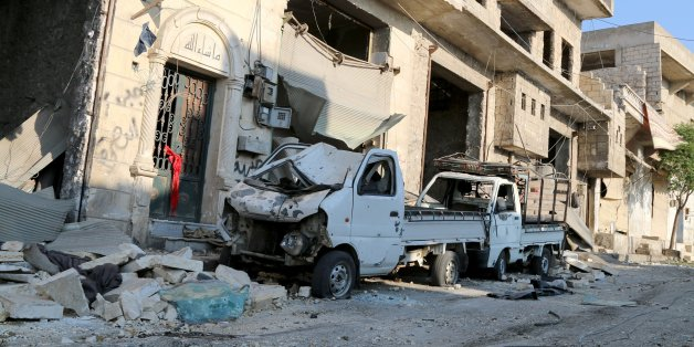 ALEPPO, SYRIA - AUGUST 7: A damaged vehicle is seen after a helicopter belonging to Syrian army hit the residential area with barrel bombs, which have explosive hoses, in Aleppo's Darat Izza district, Syria on August 7, 2016. (Photo by Alm Aldeen Al Sabbagh/Anadolu Agency/Getty Images)