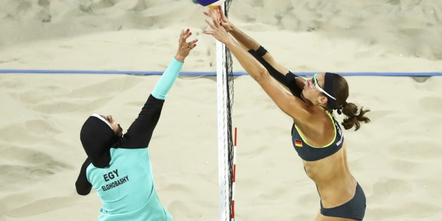 2016 Rio Olympics - Beach Volleyball - Women's Preliminary - Beach Volleyball Arena - Rio de Janeiro, Brazil - 07/08/2016. Doaa Elghobashy (EGY) of Egypt and Kira Walkenhorst (GER) of Germany compete.  REUTERS/Lucy Nicholson  FOR EDITORIAL USE ONLY. NOT FOR SALE FOR MARKETING OR ADVERTISING CAMPAIGNS.