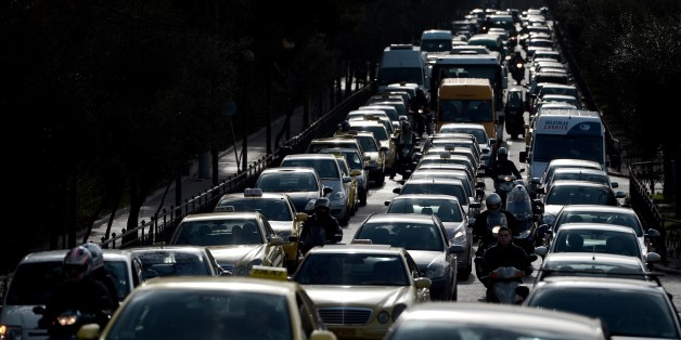 Vehicles are stuck in traffic on a main road leading to the center of Athens on January 22, 2013, due to a strike of the metro employees. Striking subway workers in Athens defied a court order to return to work and continued their protest for a sixth day to protest against salary cuts that are part of the new round of the austerity measures. AFP PHOTO / ARIS MESSINIS        (Photo credit should read ARIS MESSINIS/AFP/Getty Images)