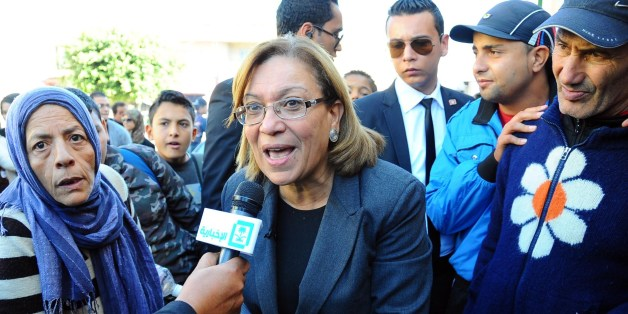 Former chairwomen of the Tunisian magistrates association and candidate for the Tunisian presidential elections Kalthoum Kannou (C) speaks to the press as she campaigns in Ettadhamen city, west of Tunis, on November 19, 2014. Kannou, the only woman in the race, is a magistrate and champion of judicial independence who was a staunch opponent of Ben Ali's regime. AFP PHOTO / MOHAMED KHALIL        (Photo credit should read Mohammed Khalil/AFP/Getty Images)