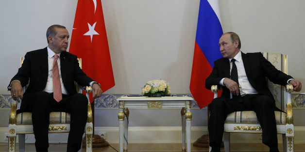 Russian President Vladimir Putin, right, and Turkish President Recep Tayyip Erdogan talk during their meeting in the Konstantin palace outside St.Petersburg, Russia, on Tuesday, Aug. 9, 2016.  President Erdogan travels to Russia to meet with President Putin for the first time since apologizing in late June for the downing of a Russian fighter jet along the Syrian border in November last year. (AP Photo/Alexander Zemlianichenko)