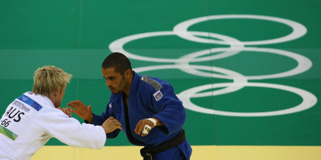 BEIJING - AUGUST 10: Mounir Benamadi (R) of Algeria competes with Steven Brown of Australia in the Men's -66 kg Preliminary contest during day 2 of the Beijing 2008 Olympic Games at the University of Science and Technology Beijing Gymnasium on August 10, 2008 in Beijing, China.  (Photo by Clive Rose/Getty Images)