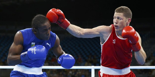 2016 Rio Olympics - Boxing - Preliminary - Men's Middle (75kg) Round of 32 Bout 67 - Riocentro - Pavilion 6 - Rio de Janeiro, Brazil - 09/08/2016. Ilyas Abbadi (ALG) of Algeria and Mpi Anauel Ngamissengue (CGO) of Congo compete. REUTERS/Peter Cziborra  FOR EDITORIAL USE ONLY. NOT FOR SALE FOR MARKETING OR ADVERTISING CAMPAIGNS.