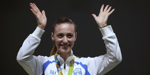 2016 Rio Olympics - Shooting - Victory Ceremony - Women's 10m Air Pistol Victory Ceremony - Olympic Shooting Centre - Rio de Janeiro, Brazil - 07/08/2016. Anna Korakaki (GRE) of Greece celebrates after winning the bronze medal.  REUTERS/Edgard Garrido FOR EDITORIAL USE ONLY. NOT FOR SALE FOR MARKETING OR ADVERTISING CAMPAIGNS.